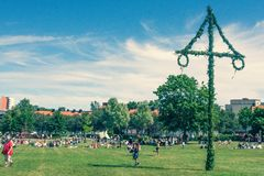 Midsummer maypole, swedish celebration sunny in a park sigtuna. A picture of a swedish Midsommarstång in a park in sigtuna, sweden stock images