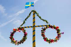 Midsummer. Flower wreath with Swedish flag Royalty Free Stock Photos