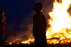 Midsummer Night. A child before a campfire at Midsummer Night celebration Royalty Free Stock Image