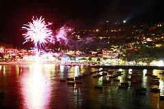 Midsummer night fireworks by the sea Stock Images