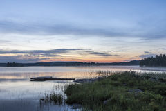 Midsummer night next to lake in Finland Stock Photography