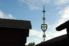 Midsummer pole above the roof tops. 
