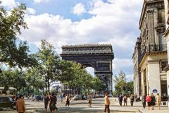 Champs-Élysées and Arc de Triomphe, Paris, France, early 1950s. A midsummer`s day, with white clouds and blue sky. Much less foot and auto traffic back then Stock Photo