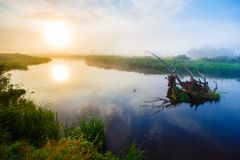 Midsummer sunrise over river curve in the countryside royalty free stock photos