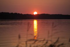 Midsummer sunset reflecting on water in southern Finland, Padva, Raseborg stock image