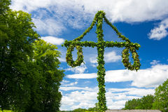 Midsummer Swedish pole. Swedish midsummer pole at blue sky Royalty Free Stock Photo