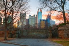 Midtown Atlanta and Piedmont Park, USA. View of stone stairs in the Piedmont Park and Midtown Atlanta behind it in autumn evening, USA Royalty Free Stock Image