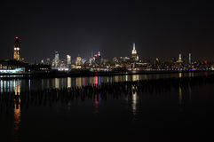 Midtown and Downtown Manhattan Lit Skyline Reflecting in the Hudson at Night as Seen from Newport Green Park in Jersey City Royalty Free Stock Photos