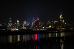 Midtown and Downtown Manhattan Lit Skyline Reflecting in the Hudson at Night as Seen from Newport Green Park in Jersey City Royalty Free Stock Photography