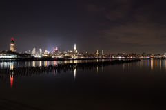 Midtown and Downtown Manhattan Lit Skyline Reflecting in the Hudson at Night as Seen from Newport Green Park in Jersey City Royalty Free Stock Photo