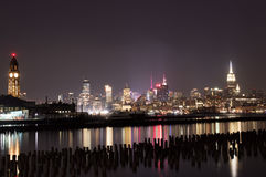 Midtown and Downtown Manhattan Lit Skyline Reflecting in the Hudson at Night as Seen from Newport Green Park in Jersey City Royalty Free Stock Image