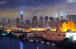 Midtown Manhattan beyond the Queens shore. New York city at dusk with the Midtown Skyline visible beyond Queens Royalty Free Stock Images