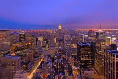 Midtown Manhattan at Dusk. Aerial view looking down on the skyscrapers and lights of Midtown Manhattan Stock Photo