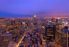 Midtown Manhattan på skymning Arkivfoto