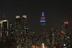 Midtown Manhattan Panorama. New York City Midtown at Night, showing Empire State Building in red and blue, the midtown area, including the glow from Times Square Royalty Free Stock Photo