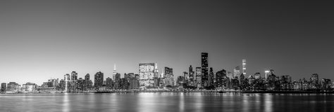 Midtown Manhattan skyline panoramic view. Black and white panoramic view of the skyline of midtown Manhattan in New York by night Stock Images