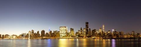 Midtown Manhattan skyline panoramic view. Panoramic view of the skyline of midtown Manhattan in New York by night Stock Photo
