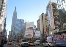 Midtown New York City. A shot of a tou bus and traffic passing throughh 34 street Royalty Free Stock Images