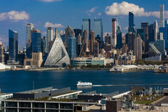 Midtown Skyline of Manhattan, New York shows VIA 57 West at 625 West 57th St. in Hell's Kitchen Pyramid  and Hudson River,  archit Stock Photos