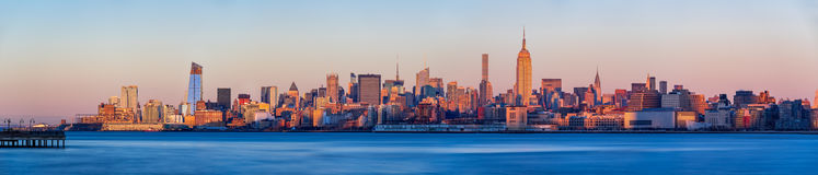 Midtown West Manhattan skyscrapers at sunset Panoramic, New York City Royalty Free Stock Photo