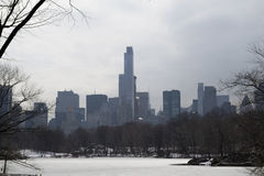 Midtown in winter from Central Park by and frozen podn Royalty Free Stock Photos