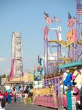 The midway at the County Fair. The midway and carnival at the County Fair on a sunny day royalty free stock image