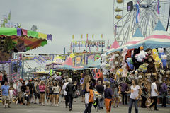 Midway, County Fair, San Diego, California. People walk the midway with amusement park rides and games at the San Diego County Fair, formerly the Del Mar Fair royalty free stock photography