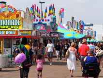 Midway At Exposition. Midway and carnival goers at K-Days, Edmonton, Alberta July 2014 Stock Images