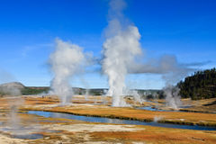 Midway Geyser Basin. Geysers send steam into the cold morning air at Midway Geyser Basin. Yellowstone National Park, Wyoming stock image