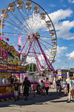 Midway at the 16th Annual Salem Fair. Salem, VA – June 29th: Food stands and merchants line the midway selling food and merchandise with a giant ferris wheel Royalty Free Stock Photos
