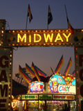 Midway at Twilight. Neon beckons from the Midway at an Agricultural Fair Stock Image