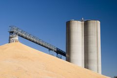Midwest elevators and corn. Midwest corn and grain elevator against the sky stock images