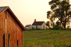 Midwest farm. Barn and shed in midwest area late in the evening while the sun is setting stock image