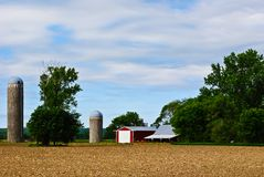 Midwest Farm. Barn, Field and Silos Against a Blue Sky on a Midwestern Farm Royalty Free Stock Photos