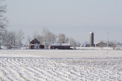 Midwest Farm on a Wintry Day. Midwest vista after a fresh snow in the winter. Farm with windmill, silo and field stock photos