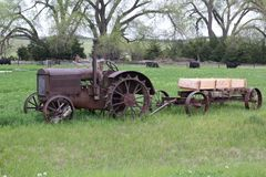 Rural Farm Yard. Midwest farm yard with an antique tractor and trailer with iron wheels stock images