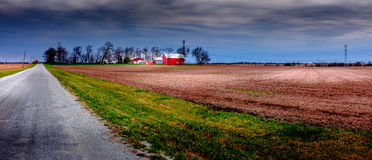 Midwest farming is getting brighter. Typical midwest farm under the spring sunshine stock photo