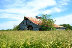 Midwest Hay Barn. A hay barn in a Midwest Field royalty free stock photo