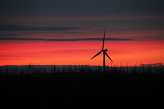 Midwest Red Sunset with Windmill Royalty Free Stock Photo