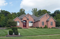 Midwest Suburban Brick Home. Large red brick home in Midwest suburbs royalty free stock photo