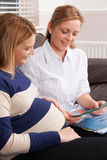 Midwife Making Home Visit To Expectant Mother Royalty Free Stock Images