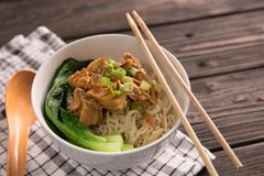 Mie or bakmi ayam. Seasoned yellow wheat noodles topped with diced chicken meat royalty free stock photography