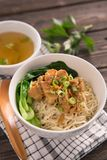 Mie or bakmi ayam. Seasoned yellow wheat noodles topped with diced chicken meat royalty free stock photo
