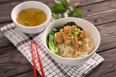 Mie or bakmi ayam. Seasoned yellow wheat noodles topped with diced chicken meat stock image