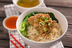 Mie or bakmi ayam. Seasoned yellow wheat noodles topped with diced chicken meat stock photo