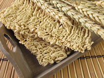 Mie noodles and wheat ears Royalty Free Stock Photo