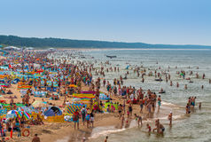 Miedzyzdroje-Poland - crowded beach in summer. Many people on beach and in sea- Baltic sea-Miedzyzdroje-Poland Royalty Free Stock Images
