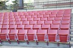 miejsca siedzące czerwony stadium Obraz Royalty Free