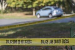 Miejsce przestępstwa taśma blokuje teren daleko Obraz Stock