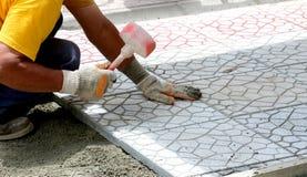 Miejski pracowników budowlanych brukować Obrazy Royalty Free